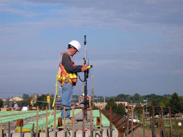 A man completing a construction survey