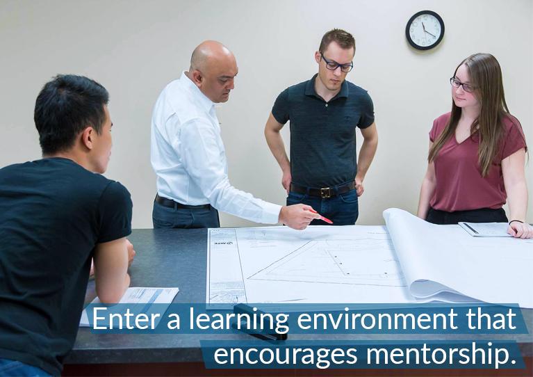 A senior leader mentoring junior staff